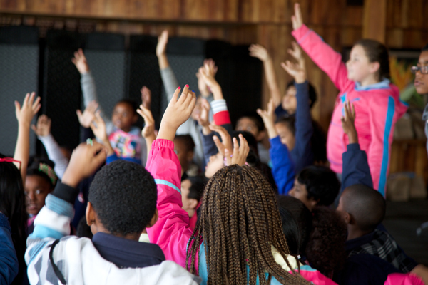 Students raise their hands during Heal the Bay's Lunch n' Learn education program at Duke's Malibu