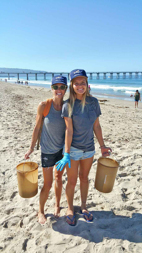 Pro surfer Bruna Schmitz (r) and Heal the Bay board member Kari Boiler at Coastal Cleanup Day
