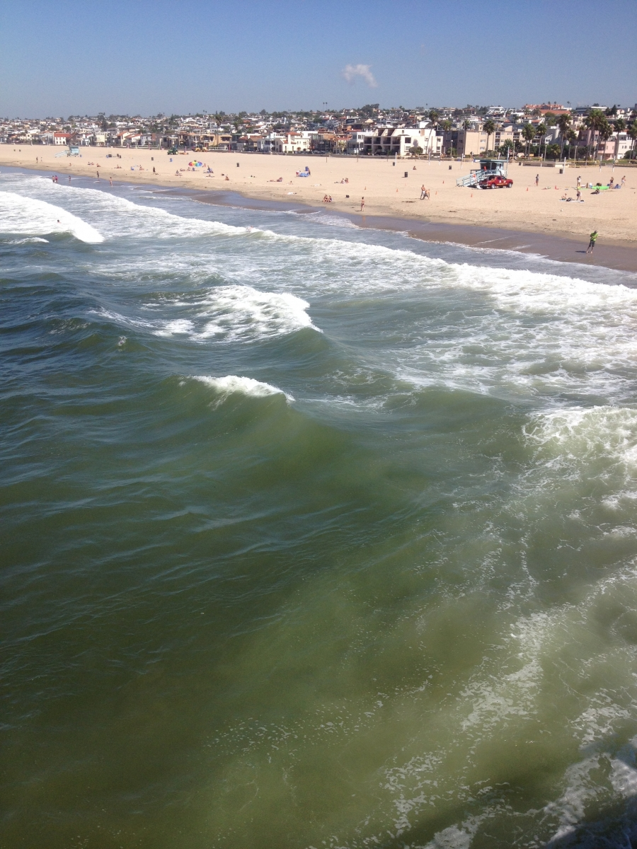 The khaki-green surf from the Hermosa Beach Pier