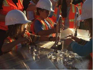 Tanner and Jasper Ford drink recycled water during a tour of West Basin's Edward C. Little Water Recycling Facility