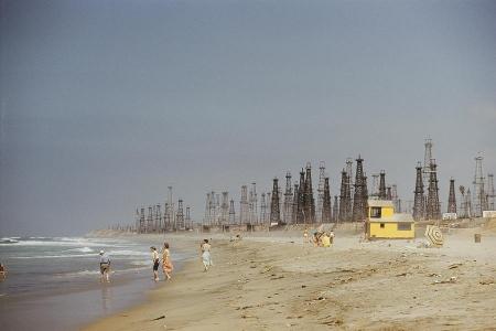 Oil rigs line Huntington Beach by J. Baylor Roberts